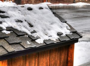snow on roof causing property damage